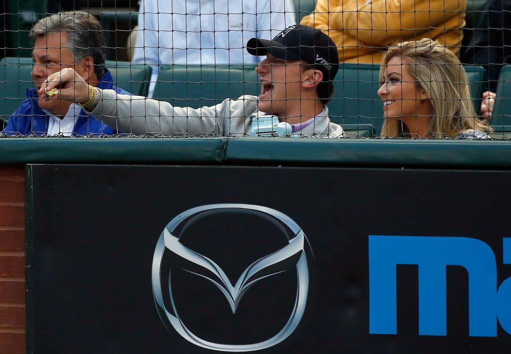 ARLINGTON, TX - APRIL 14:   Johnny Manziel quarterback of the Cleveland Browns yells at a player as the Texas Rangers take on the Los Angeles Angels at Globe Life Park in Arlington on April 14, 2015 in Arlington, Texas.  (Photo by Tom Pennington/Getty Images)
