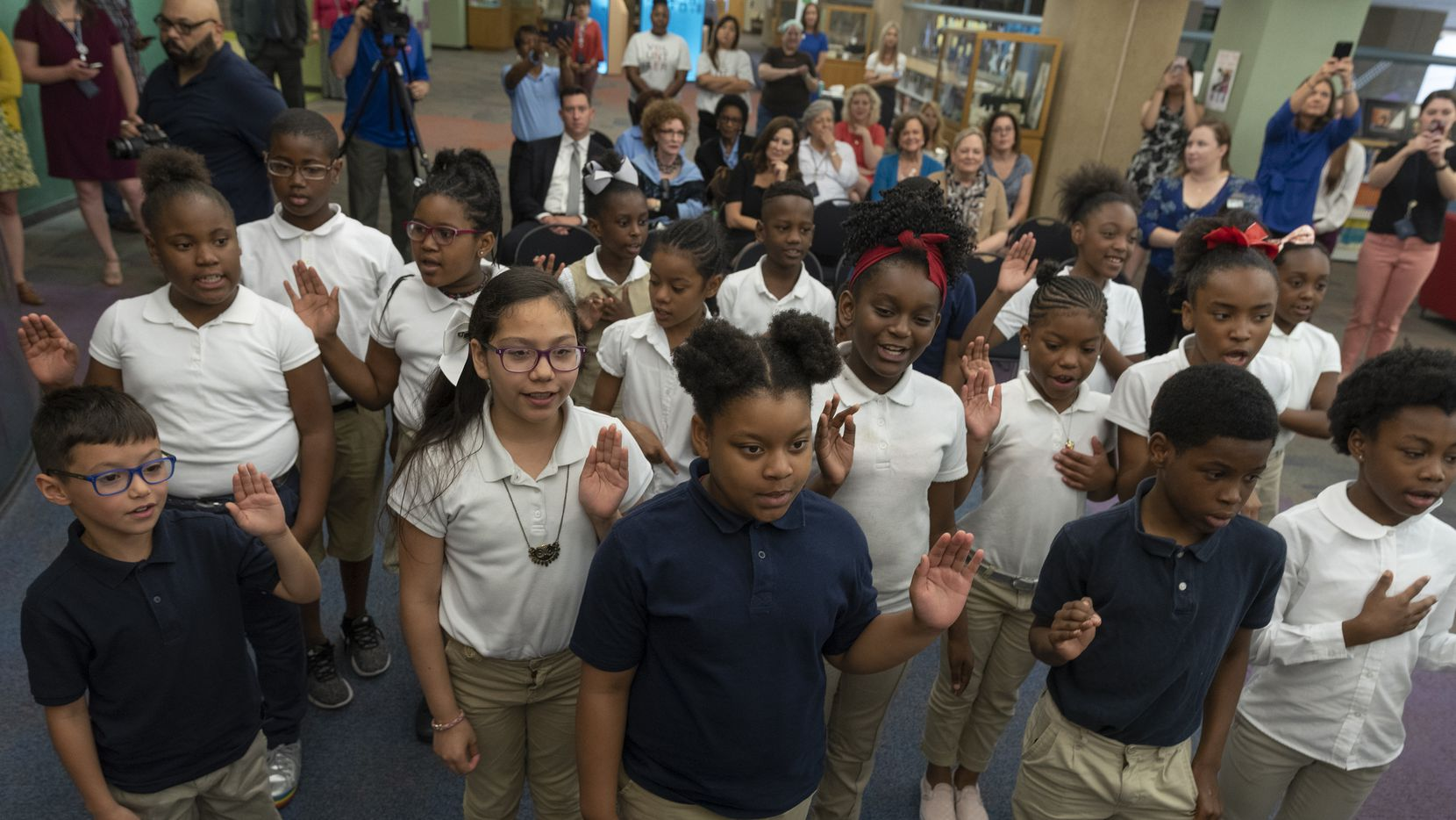 Participants took a pledge to read at least 20 minutes a day during an event launching the 2018 summer reading challenge. This year, the program goes virtual.