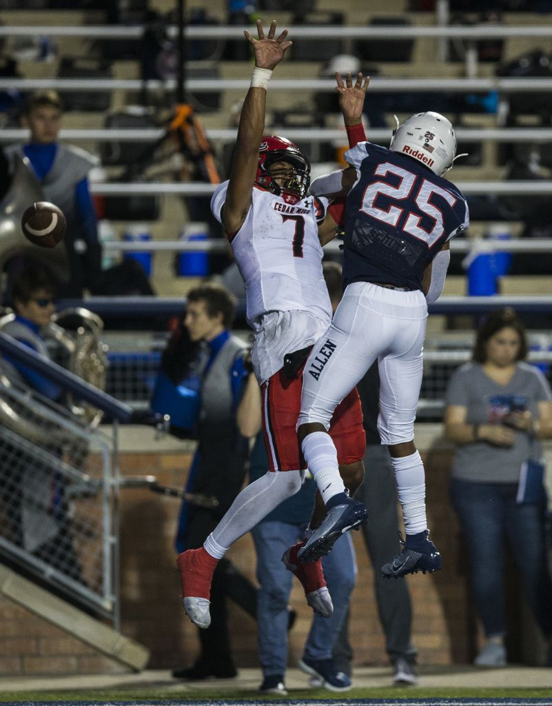 Allen defensive back Savion Richardson (25) breaks up a pass intended for Cedar Hill quarterback Kaidon Salter (7) in the end zone during the second quarter of a high school football game between Allen and Cedar Hill on Friday, August 30, 2019 at Eagle Stadium in Allen. (Ashley Landis/The Dallas Morning News)