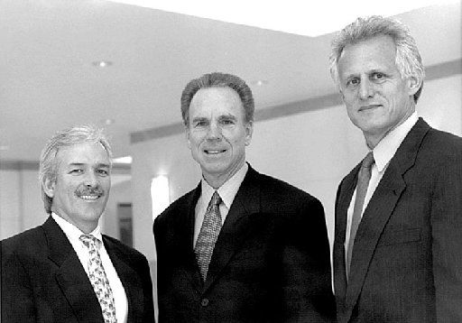 From left: Jim Leslie, Roger Staubach and Robert Shaw are shown in 2000 after announcing the formation of a development company, Amicus Partners.