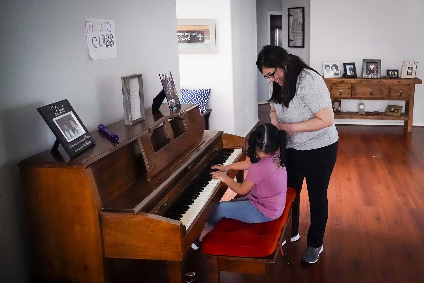 Nancy Segovia-Cabrera encourages her daughter Kamila Cabrera, 4, as she plays the piano at their home in Grand Prairie  on Wednesday, March 18, 2020.