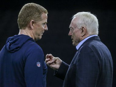 Dallas Cowboys head coach Jason Garrett, left, chats with owner Jerry Jones during the Cowboys rookie minicamp practices at The Star in Frisco, Texas on Friday, May 10, 2019.