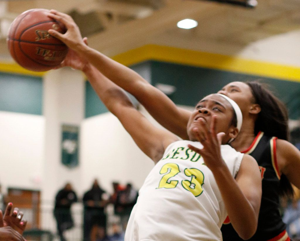 DeSoto's Kendall Brown (23) battles South Grand Prairie's Ash'a Thompson (25) for a rebound during first half action. The two teams played their District 7-6A girls basketball game at DeSoto High School in DeSoto on January 21, 2020.