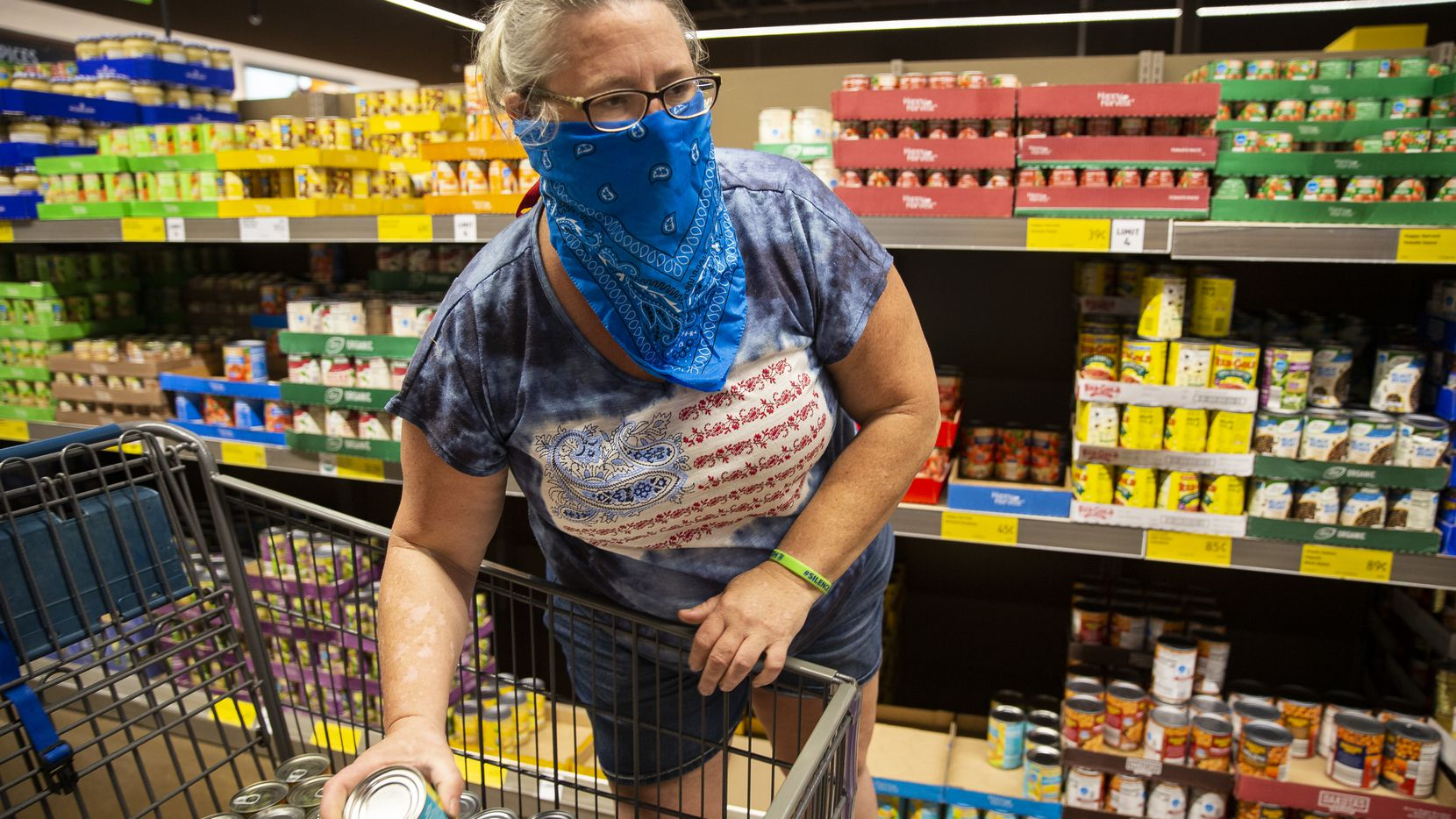 A woman shops for donations she plans to give to North Texas Food Bank at Aldi on Saturday, June 6, 2020, in Mesquite. Wells Fargo and Feeding America will team up to host drive-up food donations in August and September.