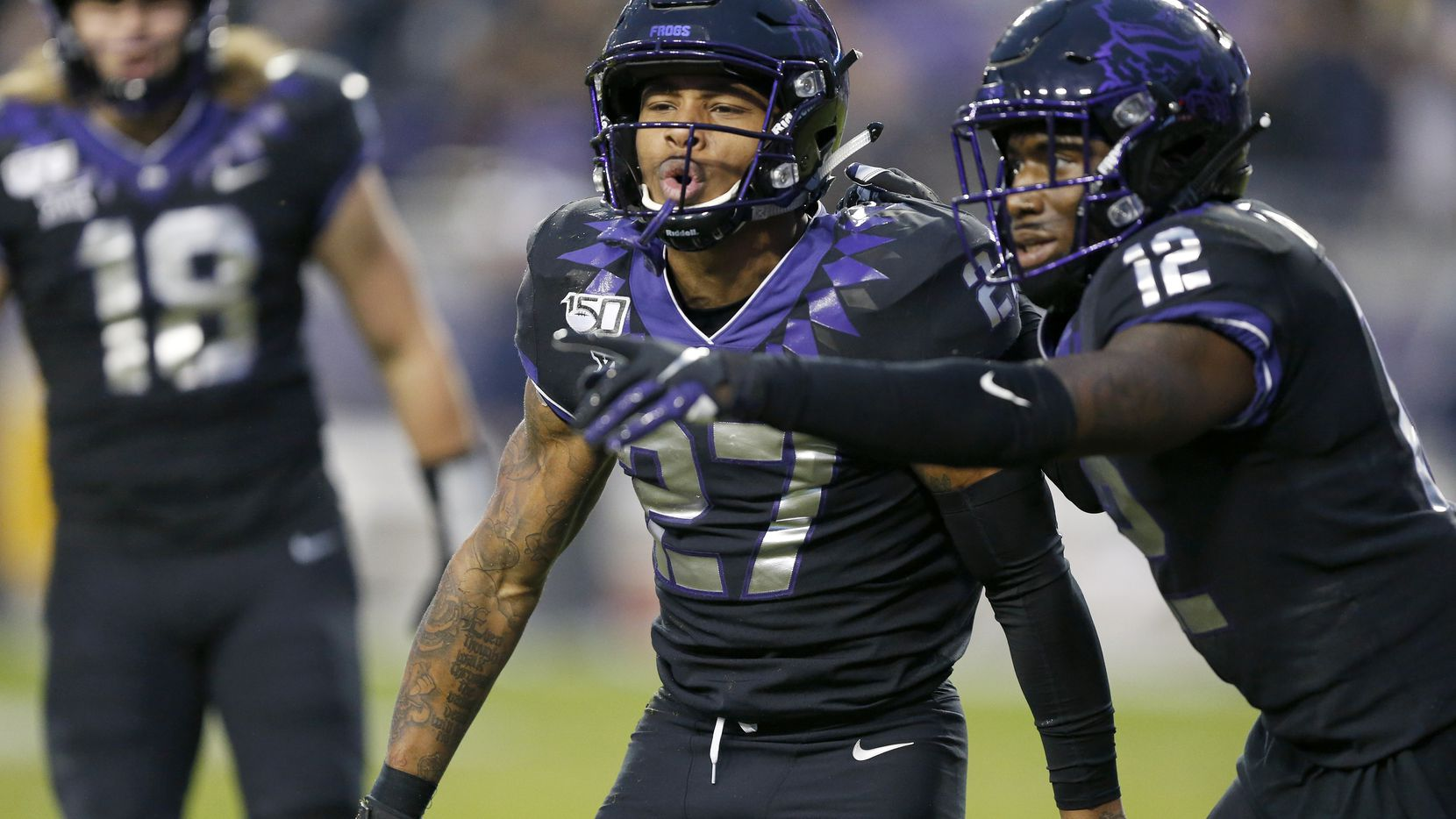 TCU Horned Frogs safety Ar'Darius Washington (27) celebrates his interception of West Virginia Mountaineers wide receiver Sam James in the second quarter at Amon G. Carter Stadium in Fort Worth, Friday, November 29, 2019.