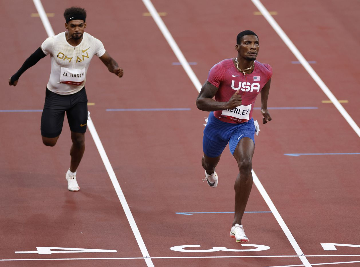 USA's Fred Kerley (right) and Barakat Al Harthi (left) race to the finish in heat 5 of 7 race of the 100 meter qualifying race during the postponed 2020 Tokyo Olympics at Olympic Stadium, on Saturday, July 31, 2021, in Tokyo, Japan. Kerley finished second with a time of 9.97 seconds to qualify for the next round. (Vernon Bryant/The Dallas Morning News)