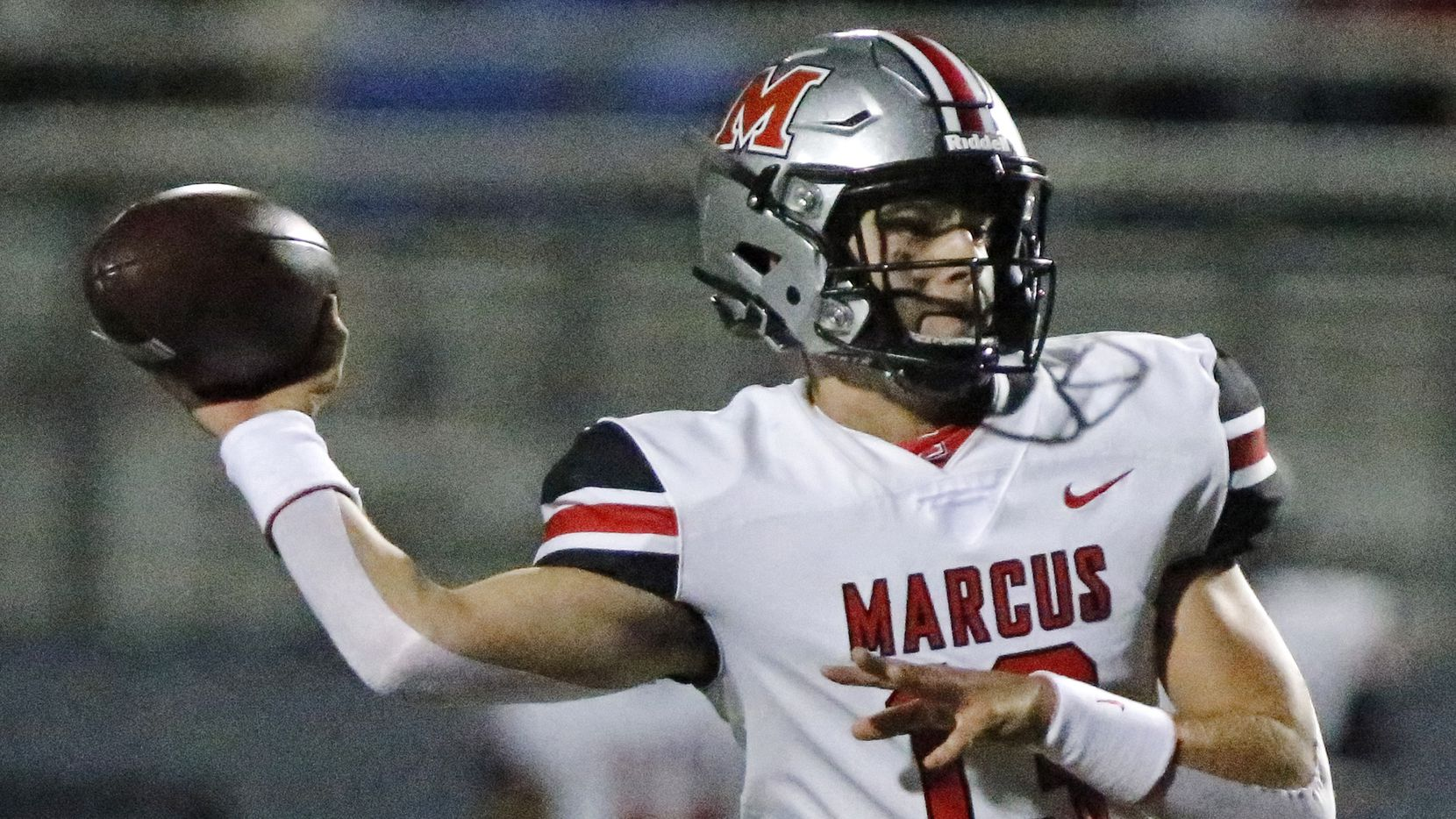 Flower Mound Marcus quarterback Garrett Nussmeier (13) throws a pass during the first half as Flower Mound High School hosted Flower Mound Marcus High School at Neal E. Wilson Jaguar Stadium on Friday night, October 23, 2020.