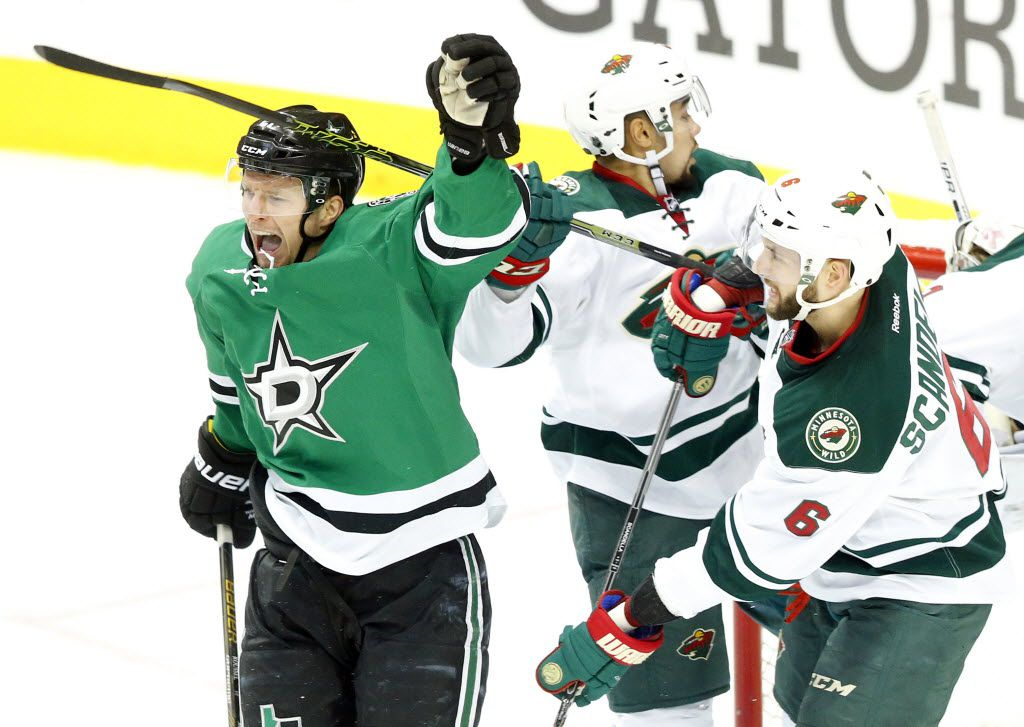 Dallas Stars left wing Antoine Roussel (21) celebrates his second period goal against Minnesota Wild defenseman Marco Scandella (6) in the second period during Game 2 of the Western Conference Quarterfinals at the American Airlines Center in Dallas, Saturday, April 16, 2016. (Tom Fox/The Dallas Morning News)