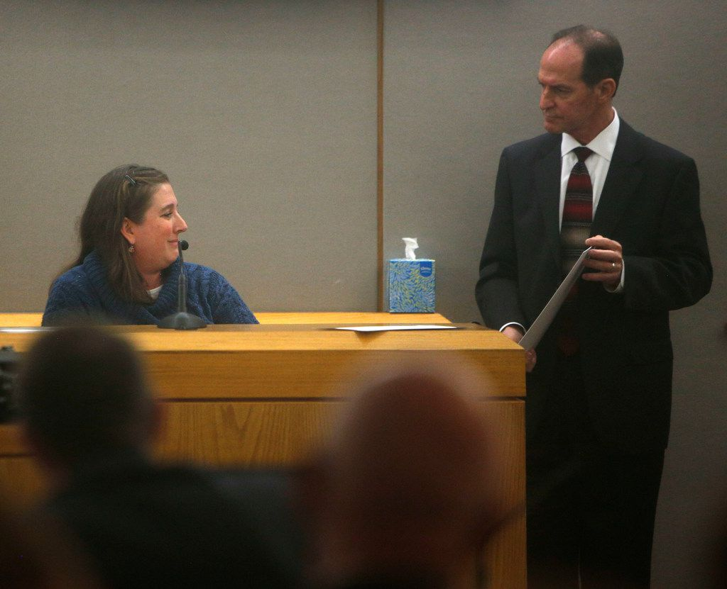 Prosecutor Pat Kirlin shows Cheryl Hastings a photo of her daughter during testimony in Antonio Cochran's capital murder trial.