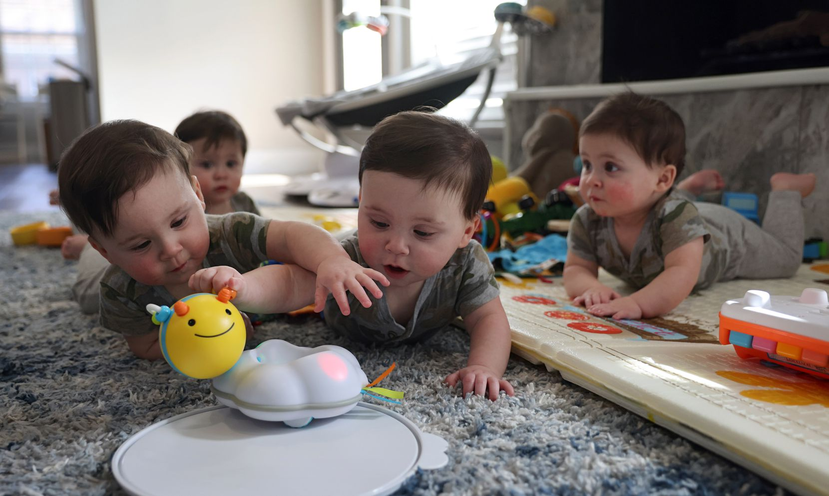 Henry (left) and Hudson (right) go after toys as Harrison (second from left) and Hardy (far right) play at the Marr home on Friday, Jan. 15, 2021, in Grapevine, Texas.