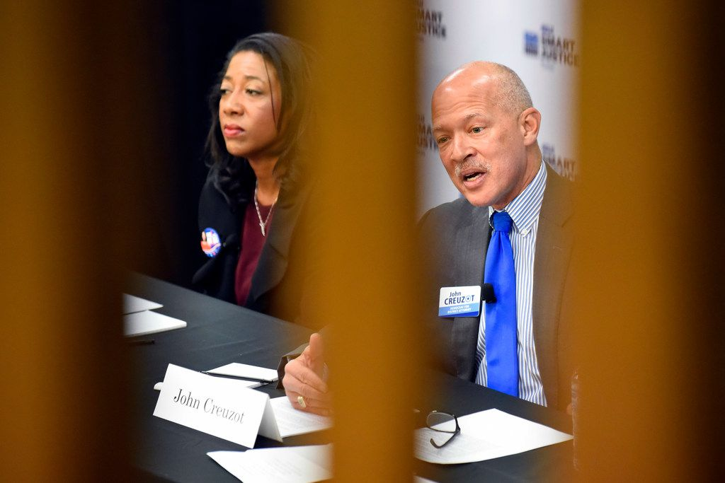 Elizabeth Frizell and John Creuzot, democratic candidates for Dallas county district attorney, answer questions Saturday during a criminal justice forum at Paul Quinn College in Dallas.