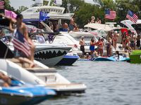 Revelers, many without masks, were out in force Saturday to celebrate Independence Day at Lewisville Lake's popular Party Cove.