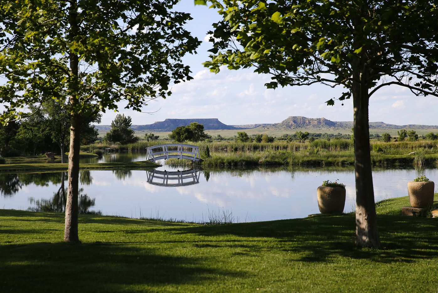 Mesas are seen across The Chapel bridge and pond on businessman T. Boone Pickens Mesa Vista Ranch.
