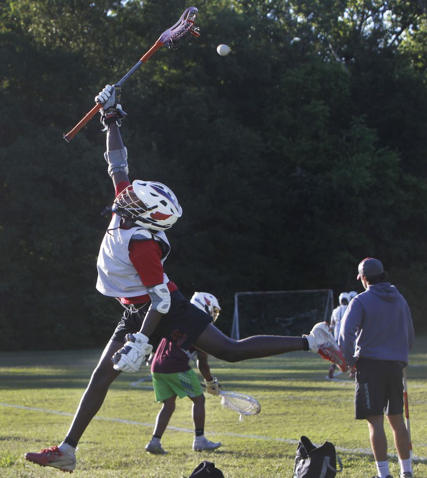 Josiah Jackson shows great athleticism as he skies in an attempt to pull down a high pass during a drill conducted during a practice session of the Bridge Eagles lacrosse team. The Bridge lacrosse team held their Wednesday evening practice session at the JC Phelps Recreation Center in Dallas on May 5, 2021.