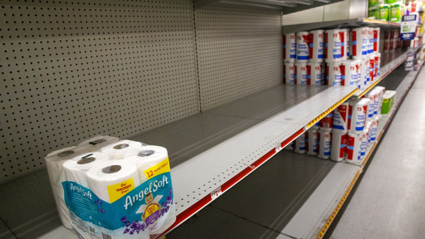 A mostly empty shelf in the toilet paper section of a Family Dollar in Pleasant Grove in southeast Dallas last week.