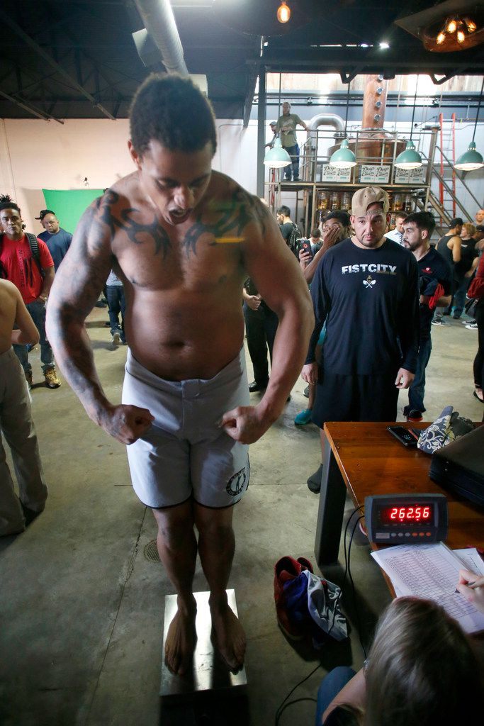 Greg Hardy flexes while standing on the scales at the Feb. 15 weigh-in for a Legacy Fighting Alliance event on Feb. 16 at The Bomb Factory in Dallas.