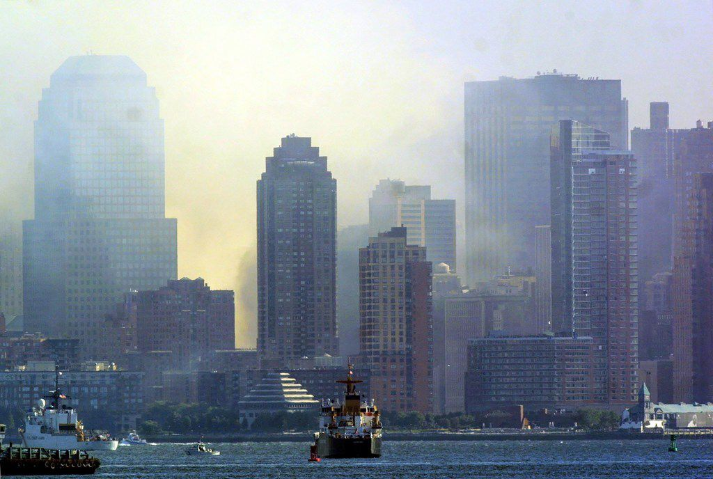In this file photo taken on Sept. 12, 2001, Lower Manhattan is seen from Staten Island in New York as smoke continues to rise from the rubble of the World Trade Center twin towers.