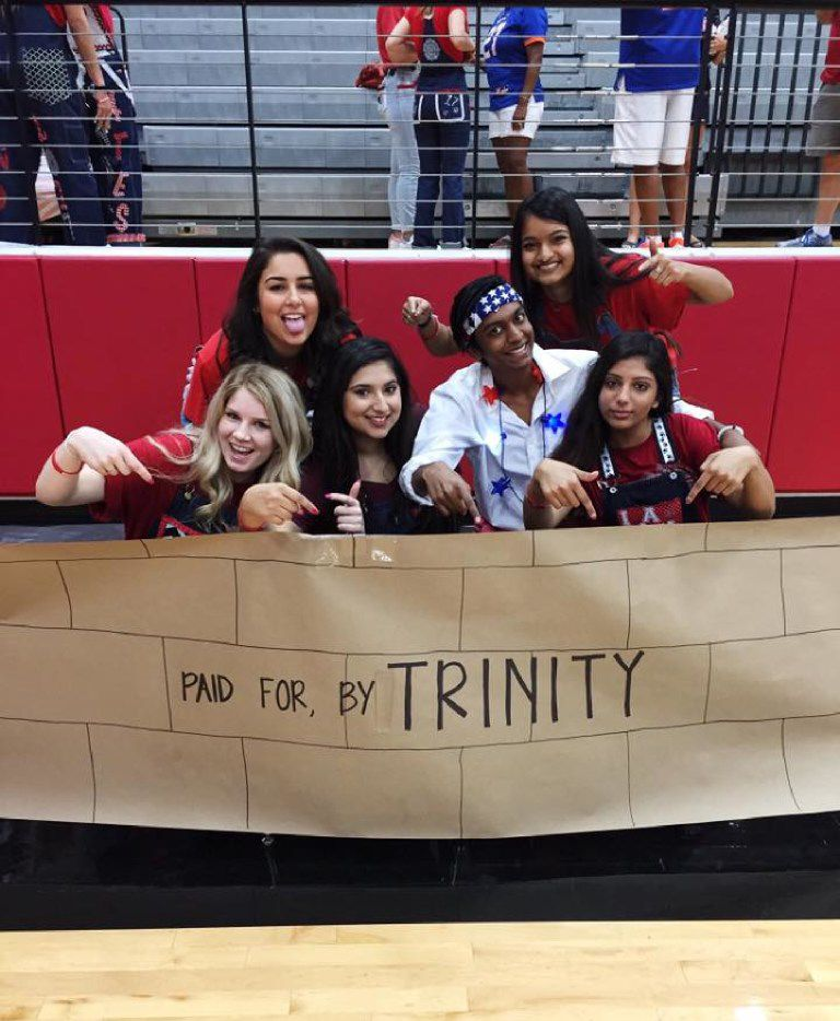 "Colleyville Heritage High School came under fire after students posted photos from a Donald Trump-themed pep rally ahead of a game against Trinity High School, which was recently named the most diverse school in Texas. One of the signs was a wall that said ""paid for by Trinity"" -- an apparent reference to Trump asking Mexico to pay for the wall he wants built on the southern U.S. border."