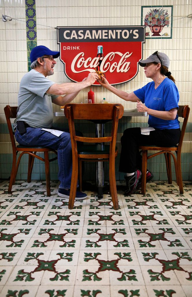 Deborah Bilsky hands her husband, Steve Bilsky, a bite of her sandwich while eating lunch in New Orleans.