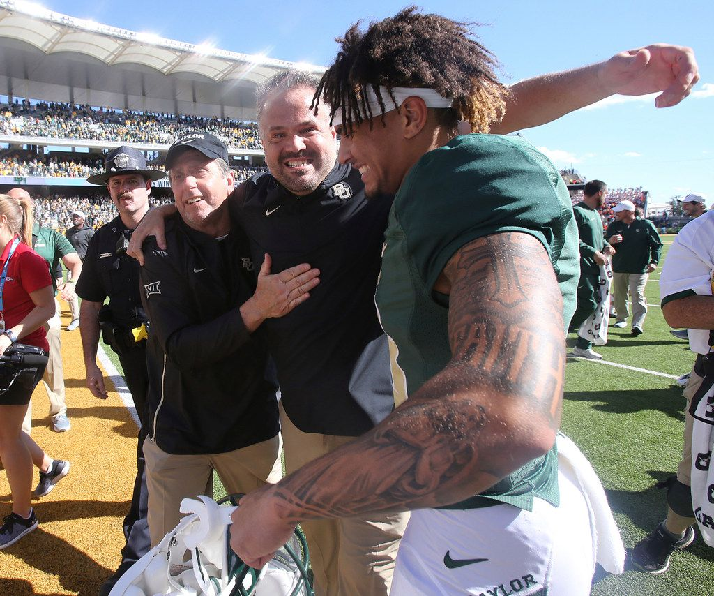 Baylor head coach Matt Rhule, center, celebrates their win against Oklahoma State with defensive coordinator Phil Snow, left, and wide receiver Gavin Holmes, right, following an NCAA college football game, Saturday, Nov. 3, 2018, in Waco, Texas.(Jerry Larson/Waco Tribune-Herald via AP)