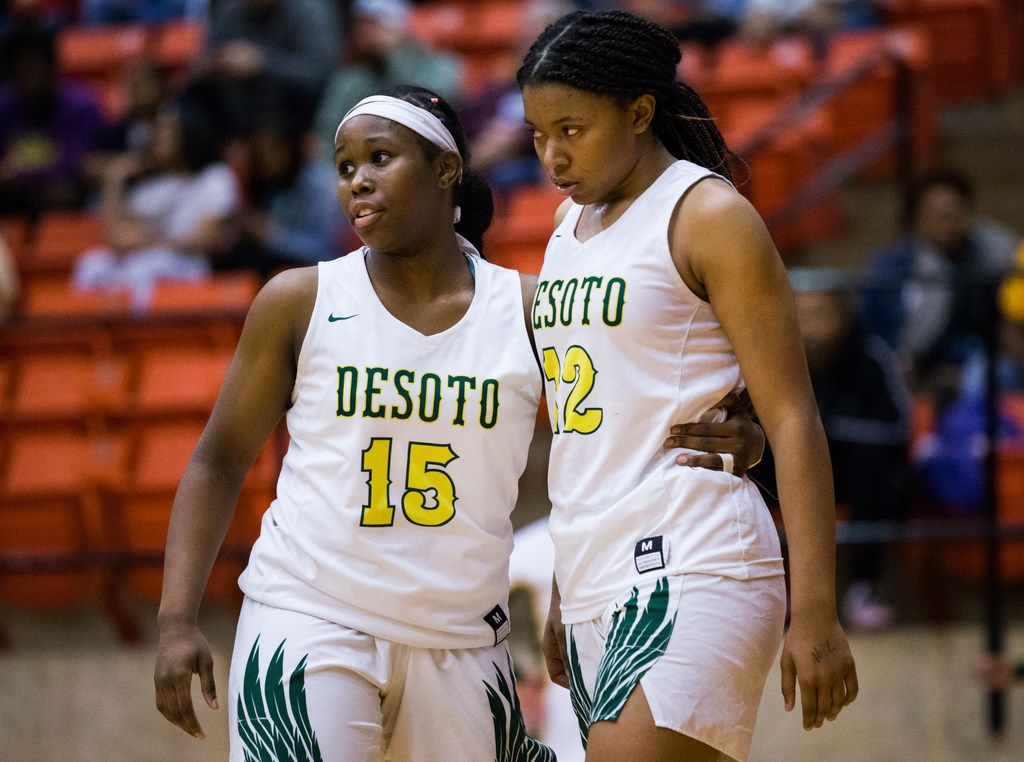 DeSoto's Michayla Gatewood (15) and Jiya Perry (12) react to a 47-43 loss after a Class 6A Region I quarterfinal girls basketball game between Duncanville and DeSoto on Tuesday, February 25, 2020 at Wilkerson-Greines Activity Center in Fort Worth. (Ashley Landis/The Dallas Morning News)