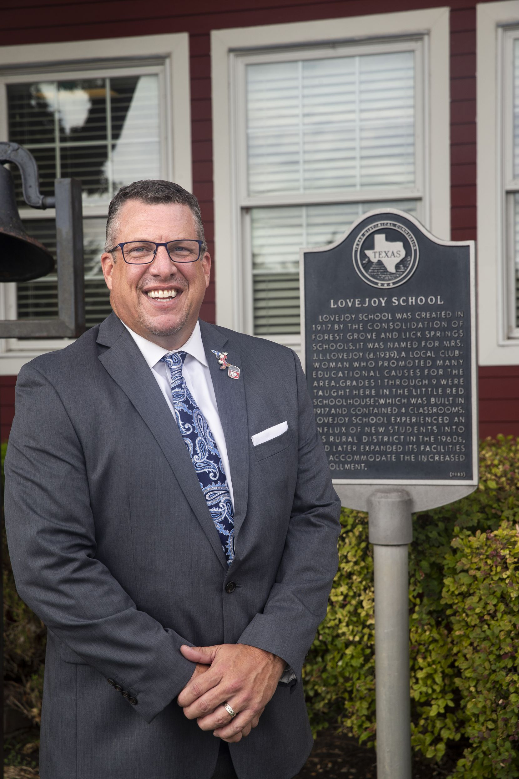 "Superintendent Dr. Michael Goddard is shown in front of the Lovejoy ISD Administration Building, known as ""The Little Red School House,"" in Allen on Sept. 1."