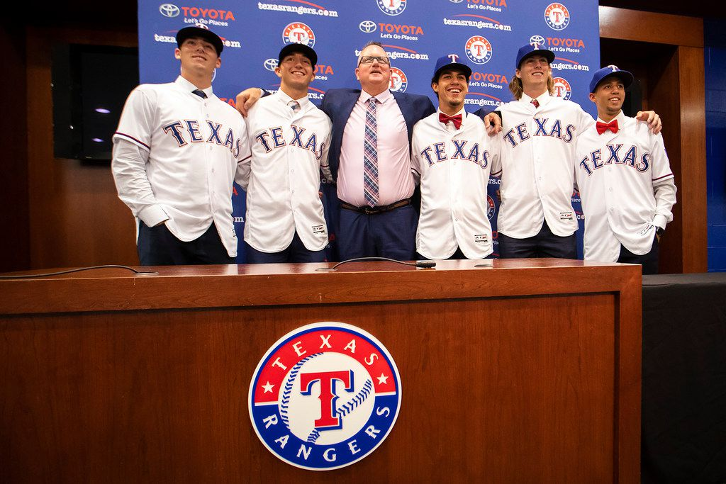 Texas Rangers Senior Director of Amateur Scouting Kip Fagg (center) poses for photos with, from left, 1st round pick, pitcher Cole Winn of Orange Lutheran (CA) High School, 2nd round pick, pitcher Owen White of Jesse Carson (NC) High School, 3rd round pick, shortstop Jonathan Ornelas of Raymond S. Kellis (AZ) High School, 4th round pick, pitcher Mason Englert  of Forney (TX) High School, and 5th round pick, shortstop Jayce Easley of Sandra Day O'Connor (AZ) High School, address the media after the team announced the signings of several of the club's draft picks from last week's MLB draft at Globe Life Park on Tuesday, June 12, 2018, in Arlington.