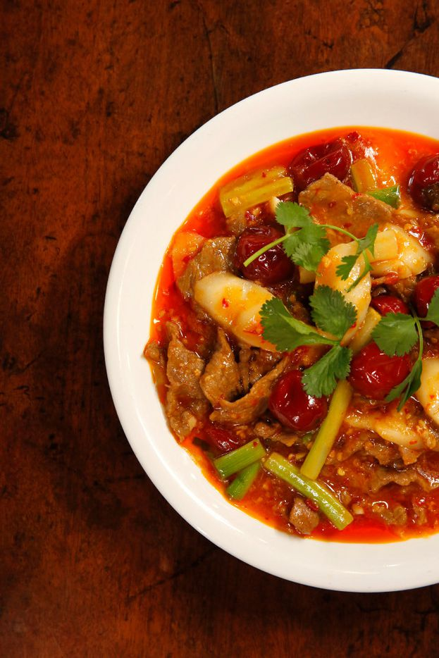 Beef with preserved chiles, rice cake and Chinese celery at Sichuan Folk (Tom Fox/Staff Photographer)
