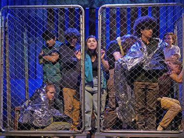 Teen actors from Cry Havoc Theater Company depict immigrants being held at the border in Crossing the Line, their co-production with Kitchen Dog Theater now running at the Trinity River Arts Center. They traveled to South Texas and Mexico to observe the immigration controversy first hand and interviewed people on all sides of the issue to create the verbatim theater work.