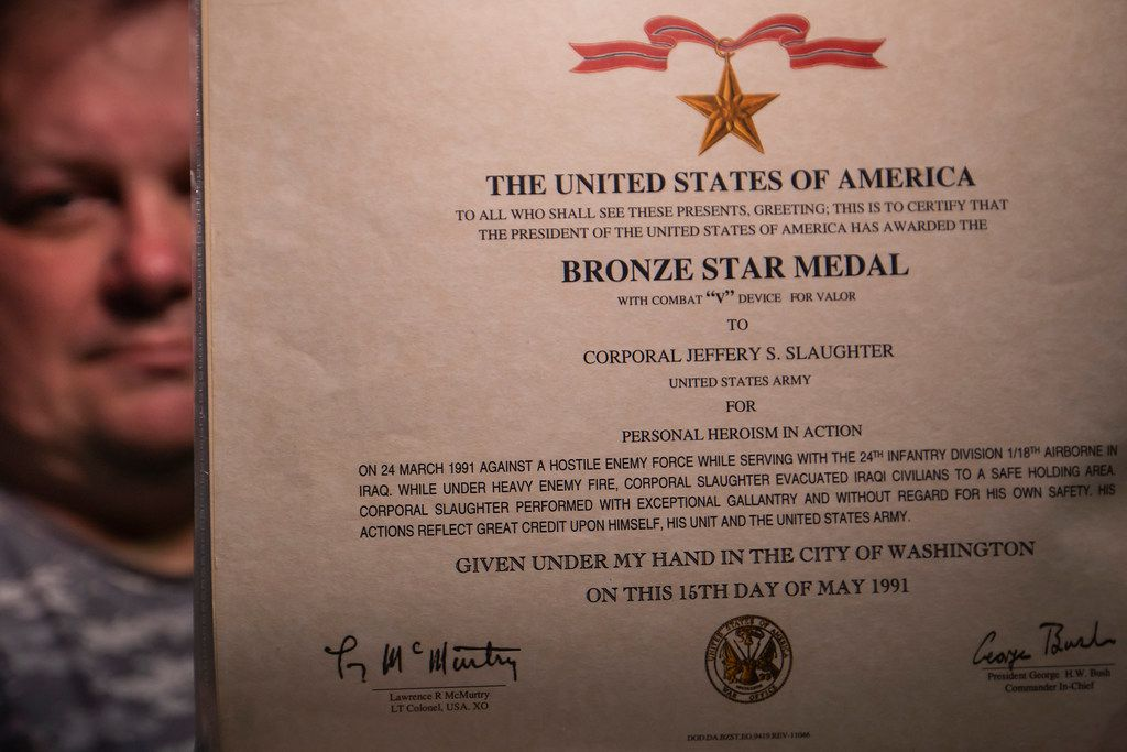 Jeff Slaughter displays the certificate for the Bronze Star awarded for his actions during the Persian Gulf War.