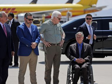 Gov. Greg Abbott (right), and U.S. Sen. John Cornyn (second from right), shown at the El Paso airport after the mass shooting there last August, on Thursday called on Bexar County GOP Chairwoman Cynthia Brehm to resign for spreading a conspiracy theory that George Floyd's death was staged.