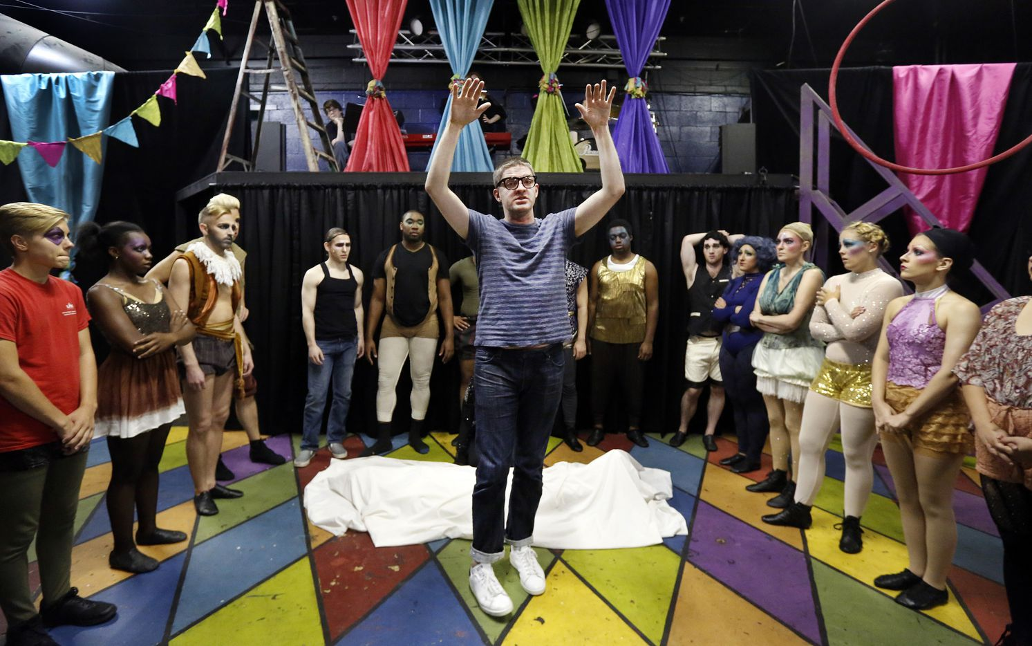 Director Derek Whitener explains to the cast how the levitation of the body will take place during a rehearsal.