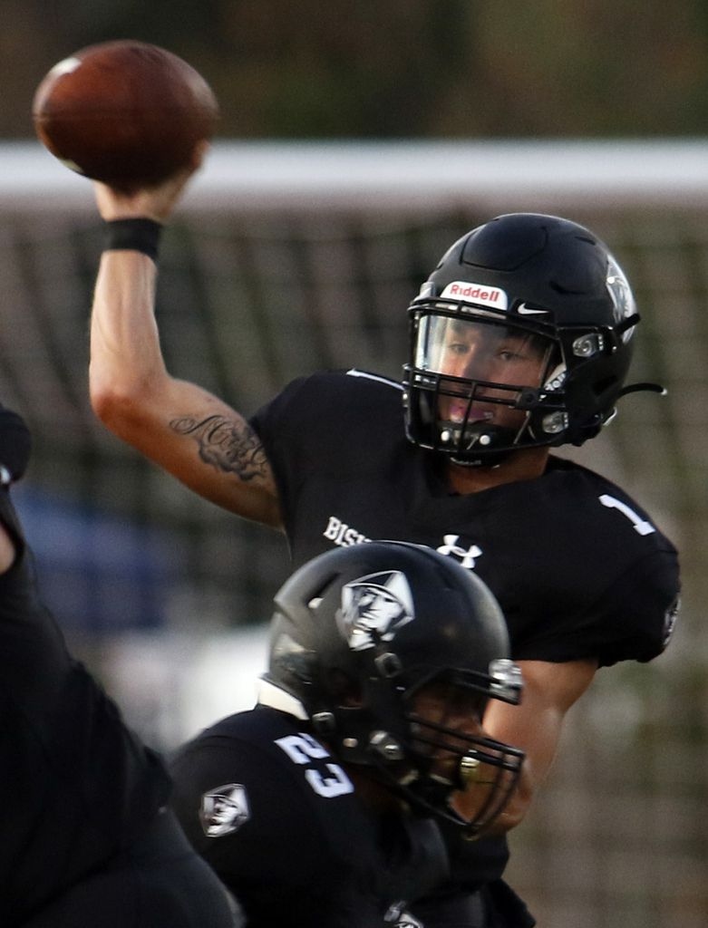 Bishop Lynch quarterback Michael Light (1) releases a pass behind the protection of running back Isaiah Schmidtke (23) during first half action against Trinity Christian-Cedar Hill. The two teams competed in their season-opening non-district football game at Roffino Stadium on the campus of Bishop Lynch High School in Dallas on August 30, 2019. (Steve Hamm/ Special Contributor)
