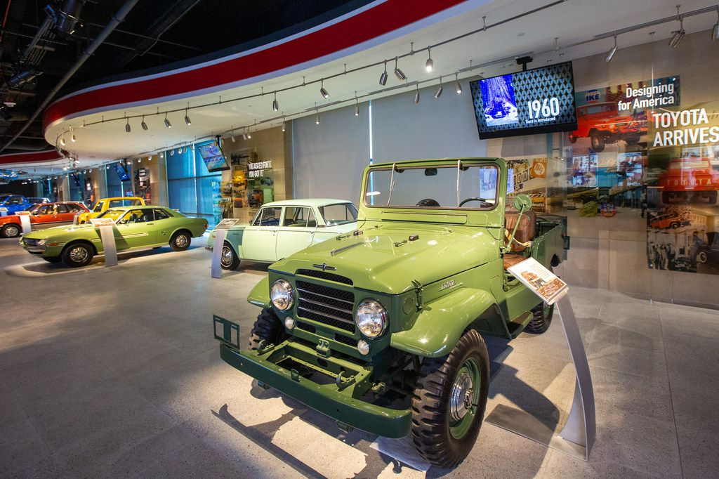 A 1961 Land Cruiser (right) and other vintage Toyota vehicles line the entrance to the Toyota Experience Center at the Toyota North American headquarters in Plano, Texas, on Wednesday, Aug. 7, 2019. The center is the motor company's first and only comprehensive museum space. (Lynda M. Gonzalez/The Dallas Morning News)
