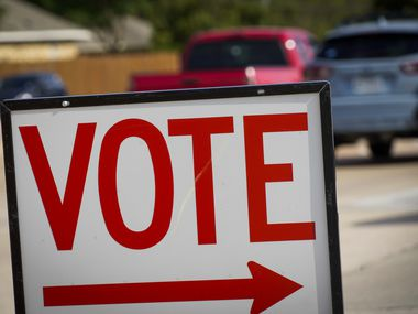 Traffic passes a polling place sign outside a Collin County Early Voting Location at Carpenter Park Recreation Center on Monday, June 29, 2020, in Plano. (Smiley N. Pool/The Dallas Morning News)