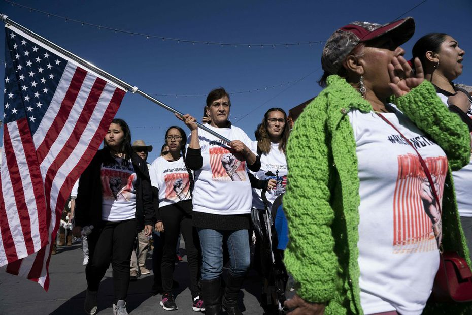 """Protestors chanted, """"No al muro!"""" (No to the wall!), during a march denouncing the border wall and calling for immigration reform in El Paso on Jan. 26, 2019."""