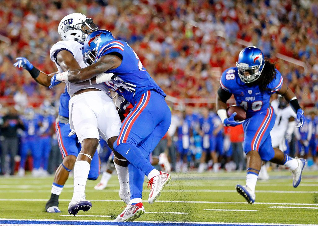 Southern Methodist Mustangs defensive back Darrion Millines (29) makes helmet to helmet contact on TCU Horned Frogs wide receiver John Diarse (9) as Mustangs linebacker Anthony Rhone (48) came down with an interception in the second quarter at Gerald J. Ford Stadium in University Park, Texas, Friday, September 23, 2016. Millines was ejected from the game for targeting. (Tom Fox/The Dallas Morning News)