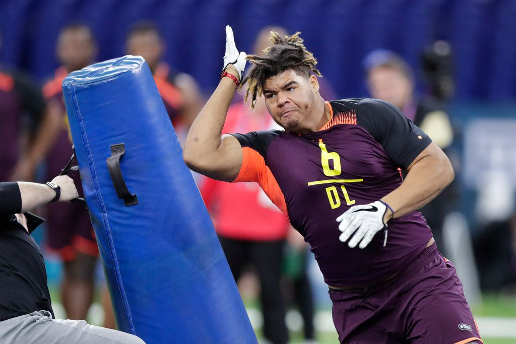 UCF defensive lineman Trysten Hill runs a drill at the NFL football scouting combine in Indianapolis, Sunday, March 3, 2019. (AP Photo/Michael Conroy) ORG XMIT: INMC10