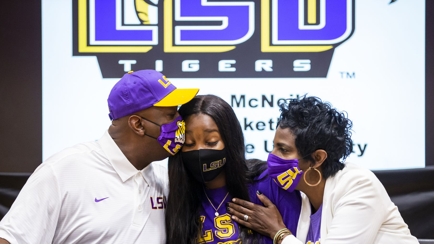 Rockwall-Heath girls basketball player Logyn McNeil is congratulated by her parents, Vincent and Sandy McNeil, during signing day at Rockwall-Heath High School in Heath, Wednesday, November 11, 2020. Logyn signed with Louisiana State University.