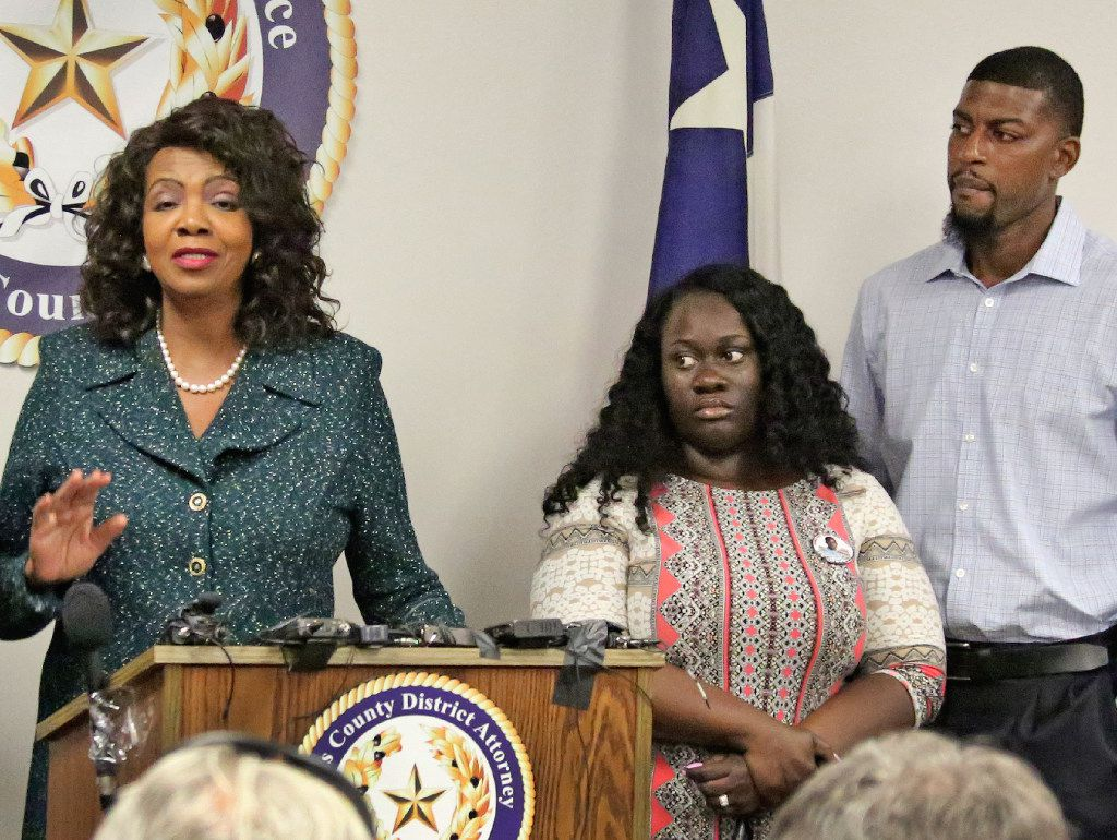Jordan Edwards' stepmother Charmaine Edwards (center) and father Odell Edwards listen as Dallas County District Attorney Faith Johnson announces that a grand jury indicted fired Balch Springs officer Roy Oliver on a murder charge for Jordan's death and four additional charges of aggravated assault with a deadly weapon by a public servant. Edwards was killed April 29 in Balch Springs as a car in which he was riding drove away from Oliver and another officer. (Louis DeLuca/The Dallas Morning News)