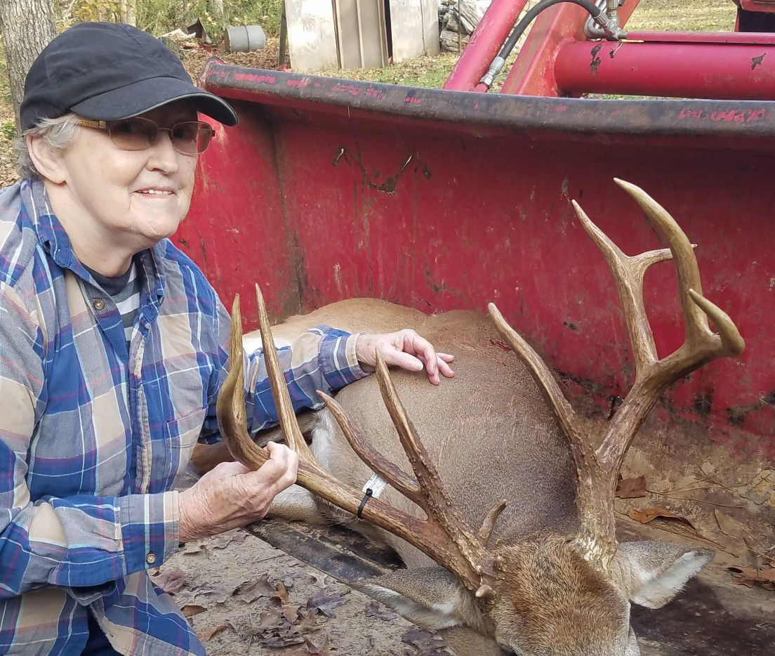 Kennard huntress Virginia Luce with the Houston County 11-pointer she bagged from her kitchen window on Nov. 8. Luce, 80, dropped the buck with one shot from her .243 at 175 yards. The deer has been gross scored at 160 2/8 B&C.