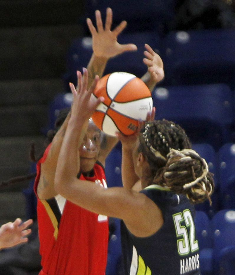Dallas Wings guard Tyasha Harris (52) shoots as she is defended by Las Vegas guard Riquana Williams (2) during first half action. The two WNBA teams played their game at College Park Center on the campus of UT-Arlington on July 11, 2021. (Steve Hamm/ Special Contributor)