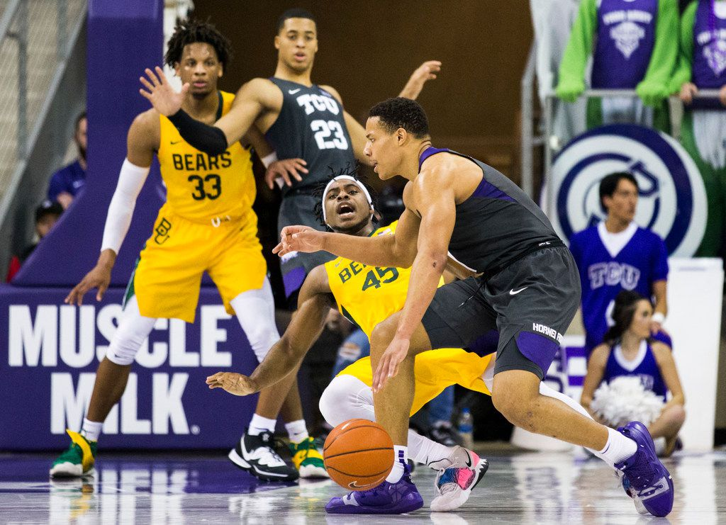 TCU Horned Frogs guard Desmond Bane (1) fouls Baylor Bears guard Davion Mitchell (45) during the first half of an NCAA mens basketball game between Baylor and TCU on Saturday, February 29, 2020 at Ed & Rae Schollmaier Arena on the TCU campus in Fort Worth. (Ashley Landis/The Dallas Morning News)
