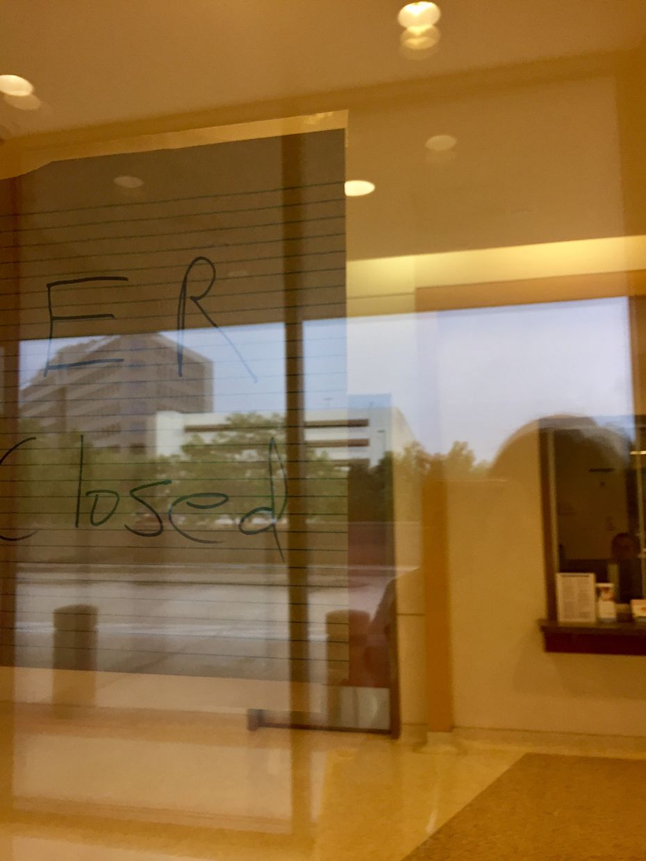 """A sign at Walnut Hill Medical Center reads, """"ER Closed."""""""