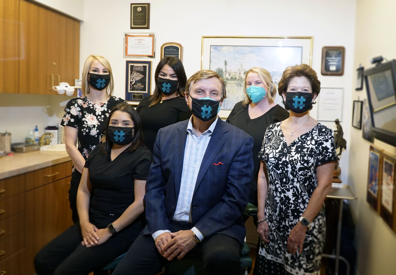 Dr. Rod Rohrich, former president of the American Society of Plastic Surgeons, with his staff at his office in Dallas on Monday.