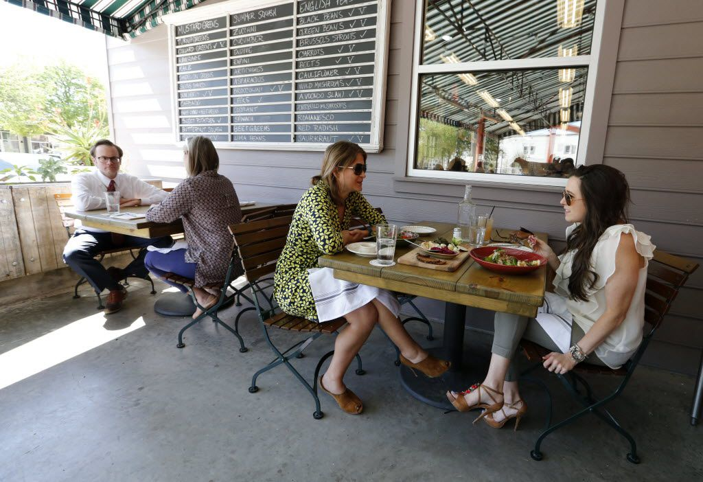 """Diners on the side patio known as the """"cow porch"""" at Mudhen"""