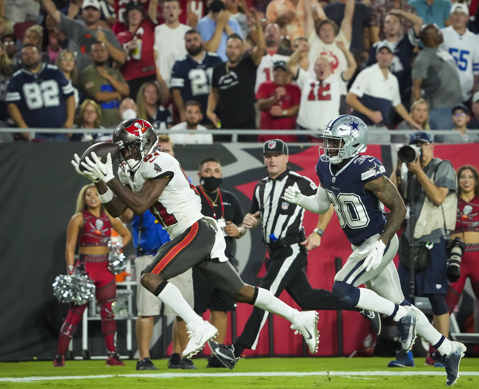 Tampa Bay Buccaneers wide receiver Antonio Brown (81) hauls in a long Dallas Cowboys catch past Dallas Cowboys cornerback Anthony Brown (30) during the first half of an NFL football game at Raymond James Stadium on Thursday, Sept. 9, 2021, in Tampa, Fla.