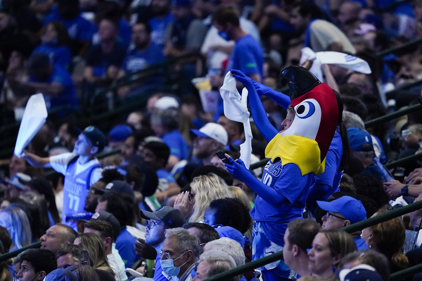 Dallas Mavericks fans dance during a timeout in the second quarter of an NBA playoff basketball game against the LA Clippers at American Airlines Center on Sunday, May 30, 2021, in Dallas.