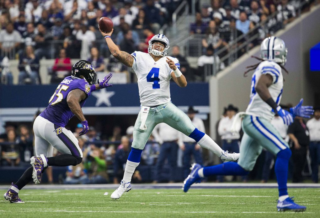 Dallas Cowboys quarterback Dak Prescott (4) throws a pass during the second quarter of their game against the Baltimore Ravens on Sunday, November 20, 2016 at AT&T Stadium in Arlington, Texas.