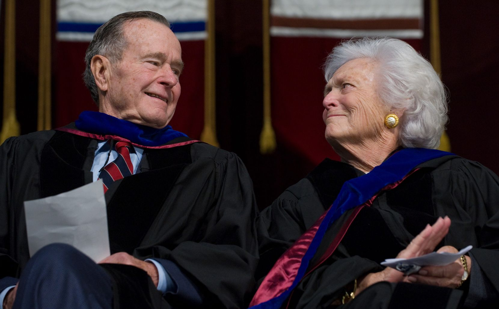2008: Former President George H.W. Bush and Barbara Bush listen as their son, President George W. Bush, delivers the commencement address during the Texas A&M University graduation ceremony in College Station.
